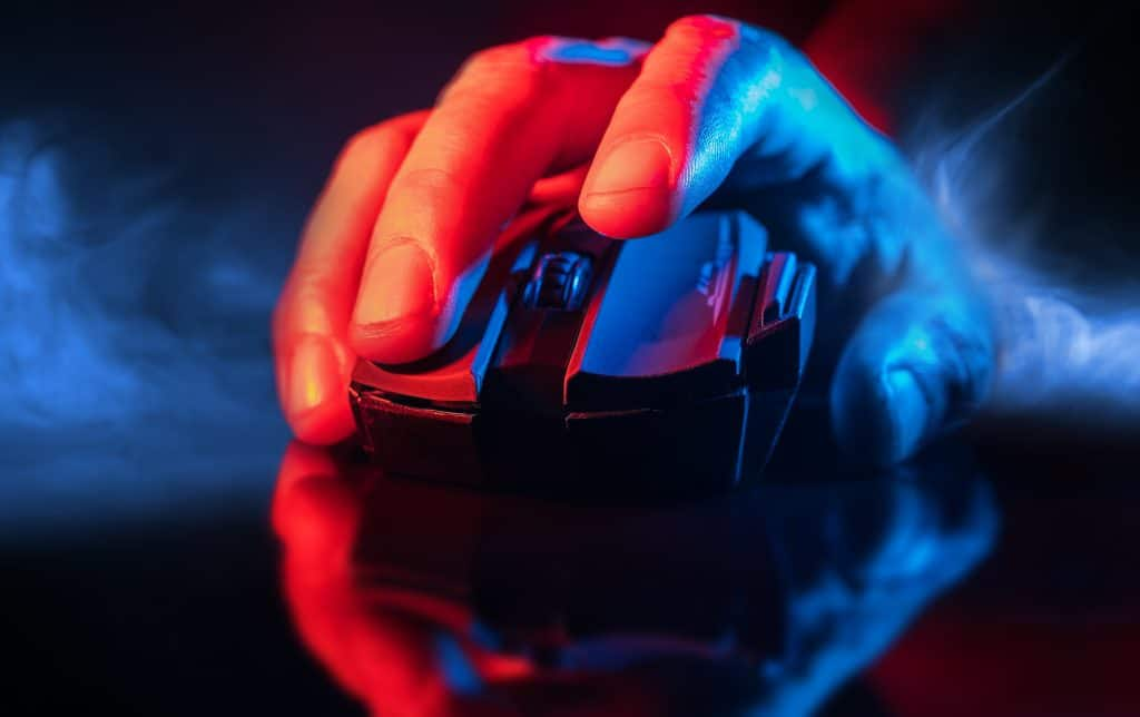 Closeup of a hand using a wireless gamer mouse.