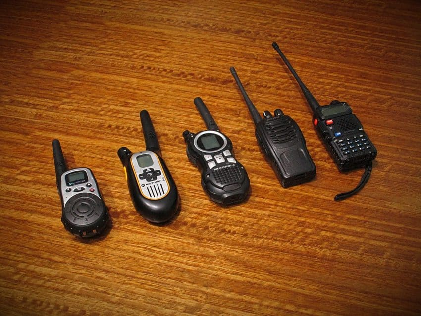 Image of five radio communicators on a table.
