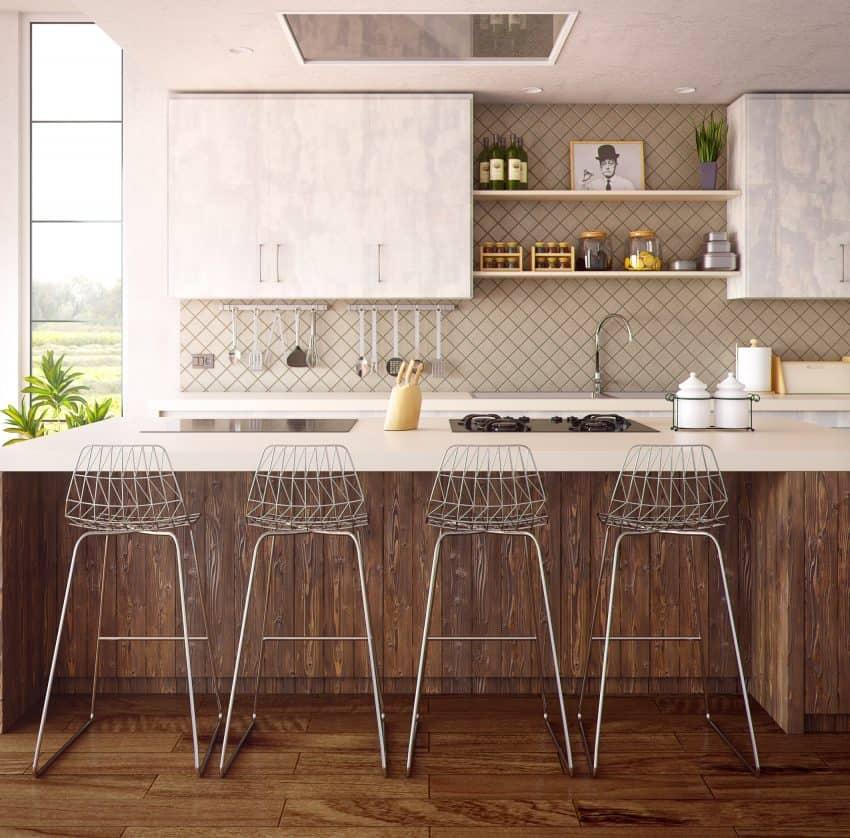 Imagem de uma bancada de cozinha, com dois tipos de fogões elétricos instalados, o por indução eletromagnética (à esquerda) e o modelo convencional (à direita).