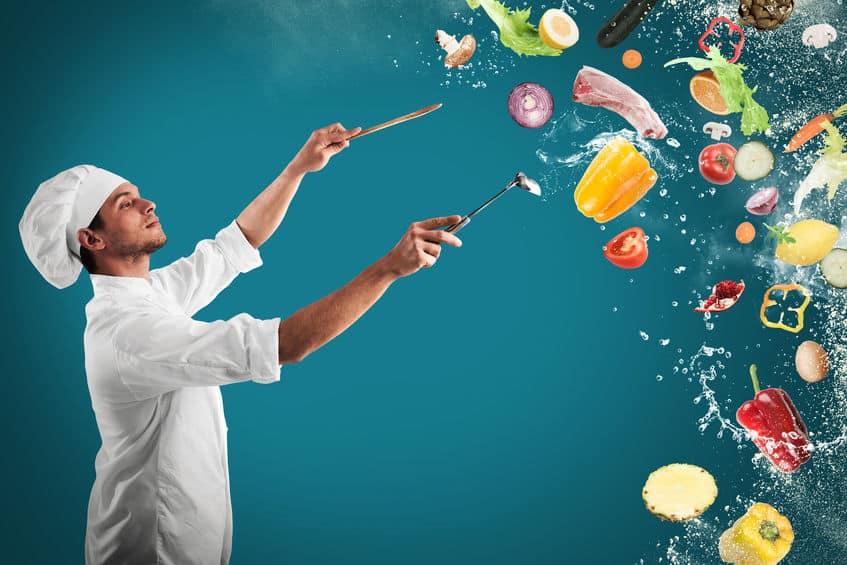 chef em fundo verde com várias comidas voando