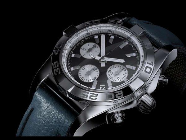 Imagem de relógio de pulso analógico sobre fundo preto.