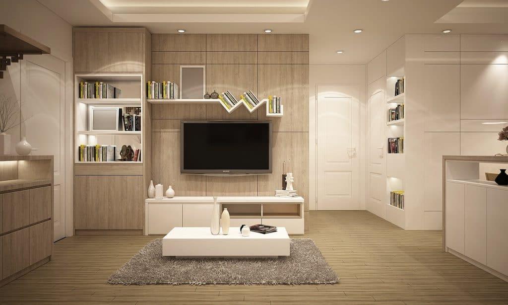 Imagem mostra sala de estar, painel com tv.