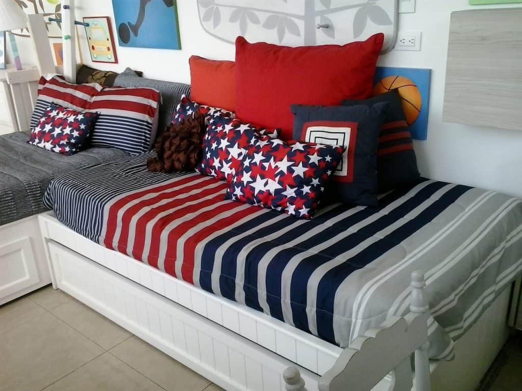 Picture of two children's beds with matching duvets.