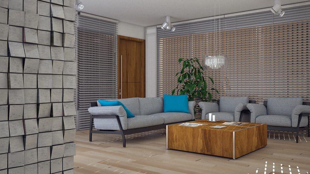 Sala de estar com sofás e mesa de centro de madeira.