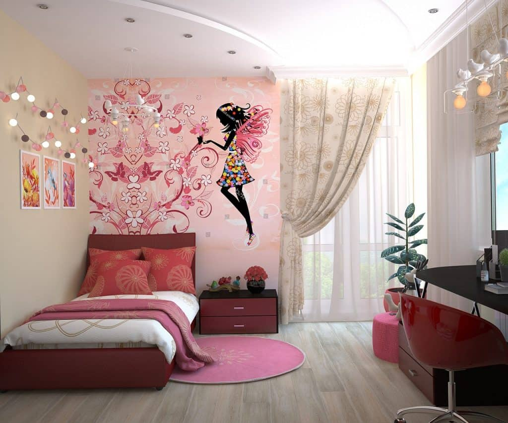 Girl's bedroom with comforter complementing decoration.