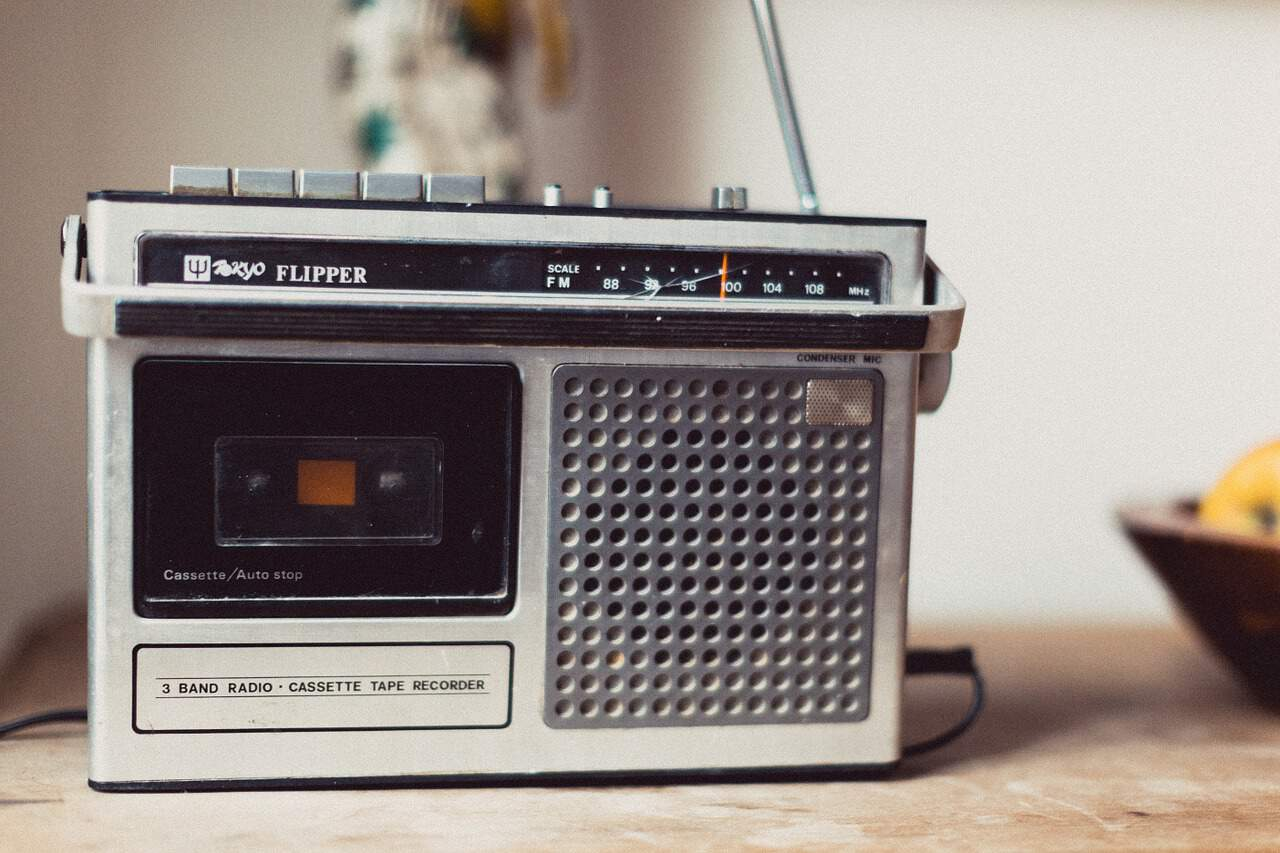 Old portable radio on a table.