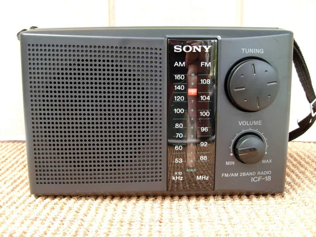 Small portable Sony radio on top of a surface
