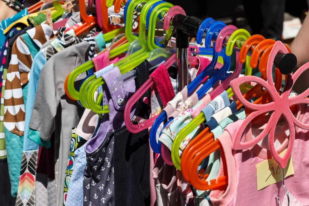 Children's clothes on hangers.