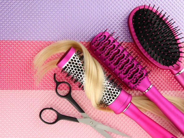 17526164 – comb brushes, hair and cutting shears, on bright background