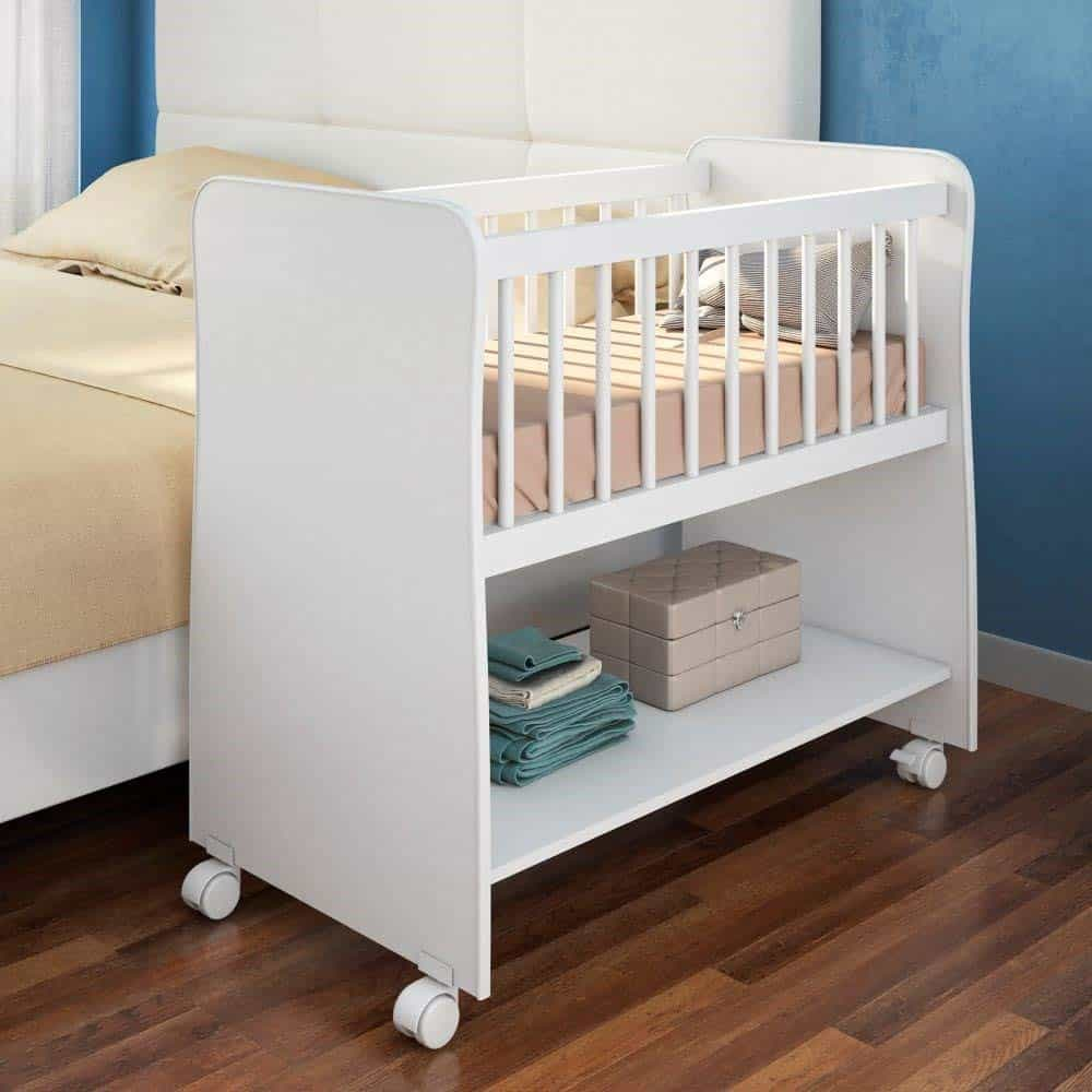 Mini crib next to the double bed.