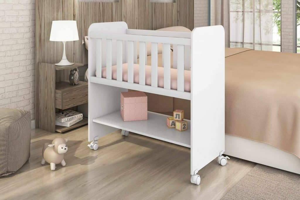 Mini crib next to parents bed.