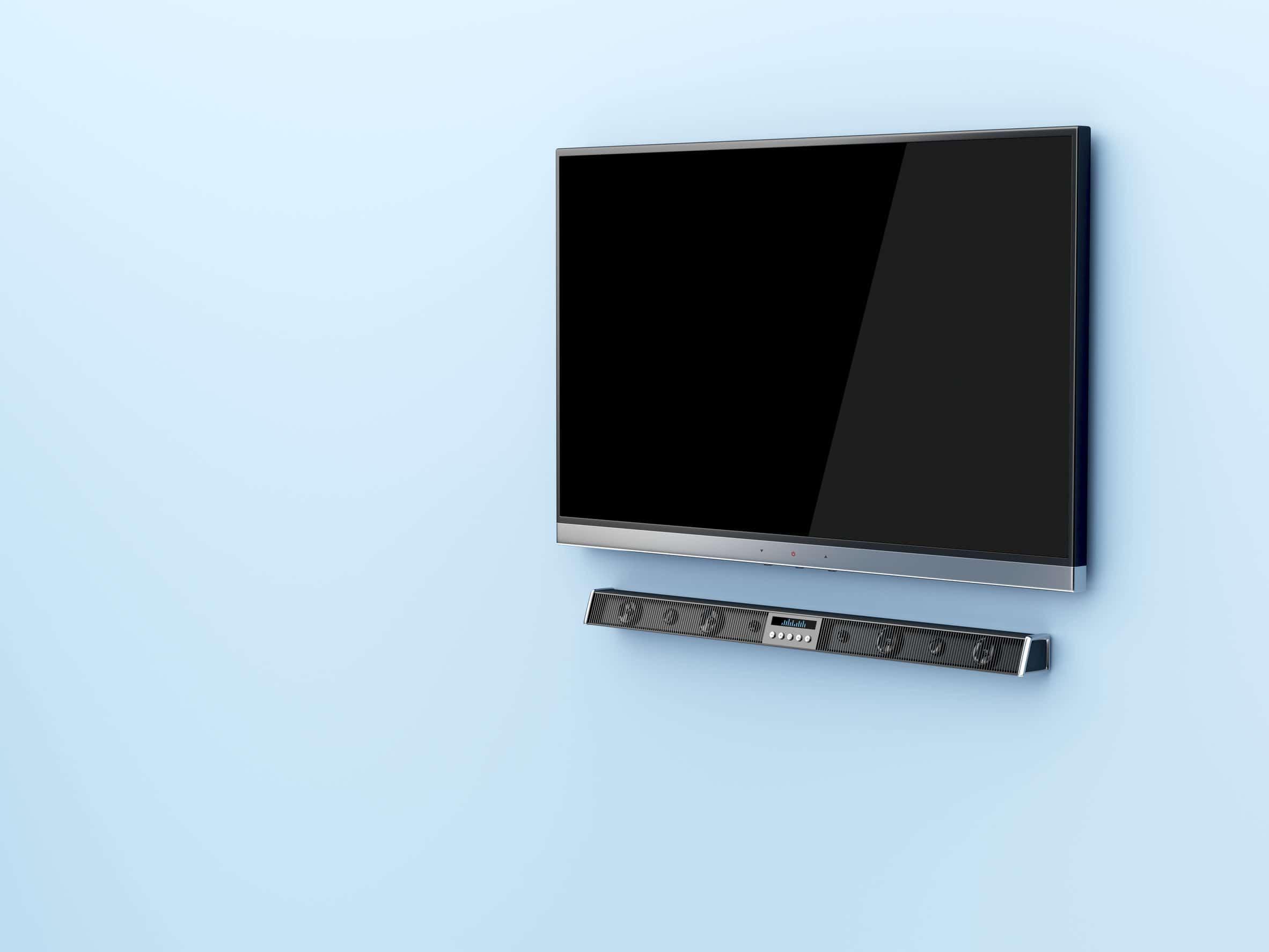 Imagem de TV com soundbar.