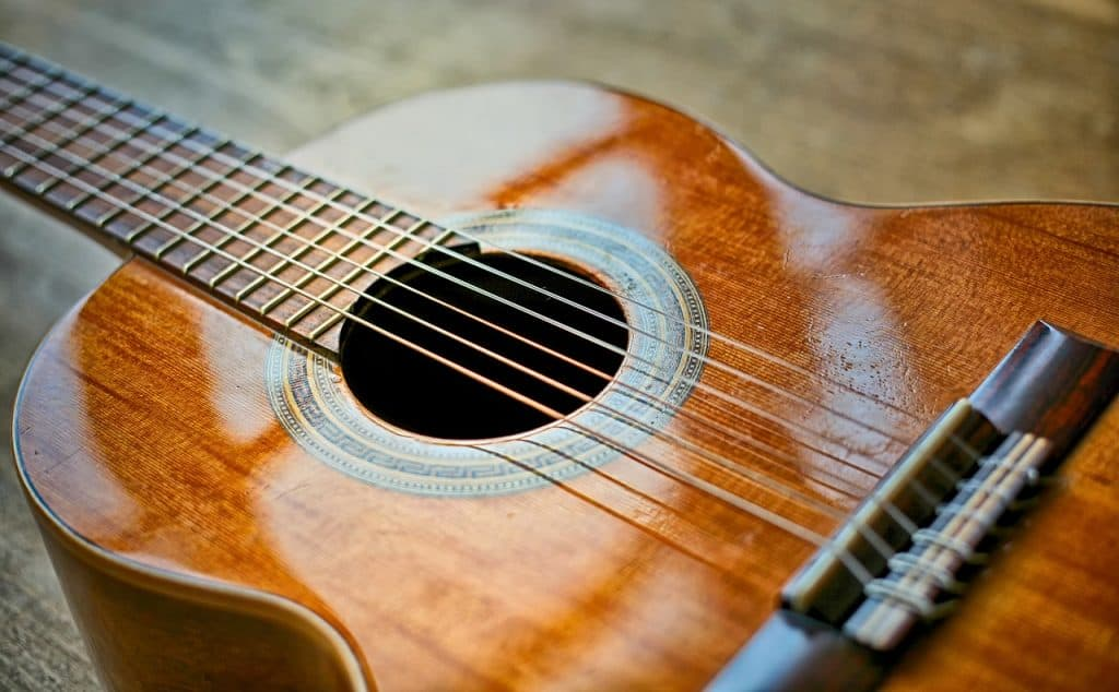 A close up on an acoustic guitar.