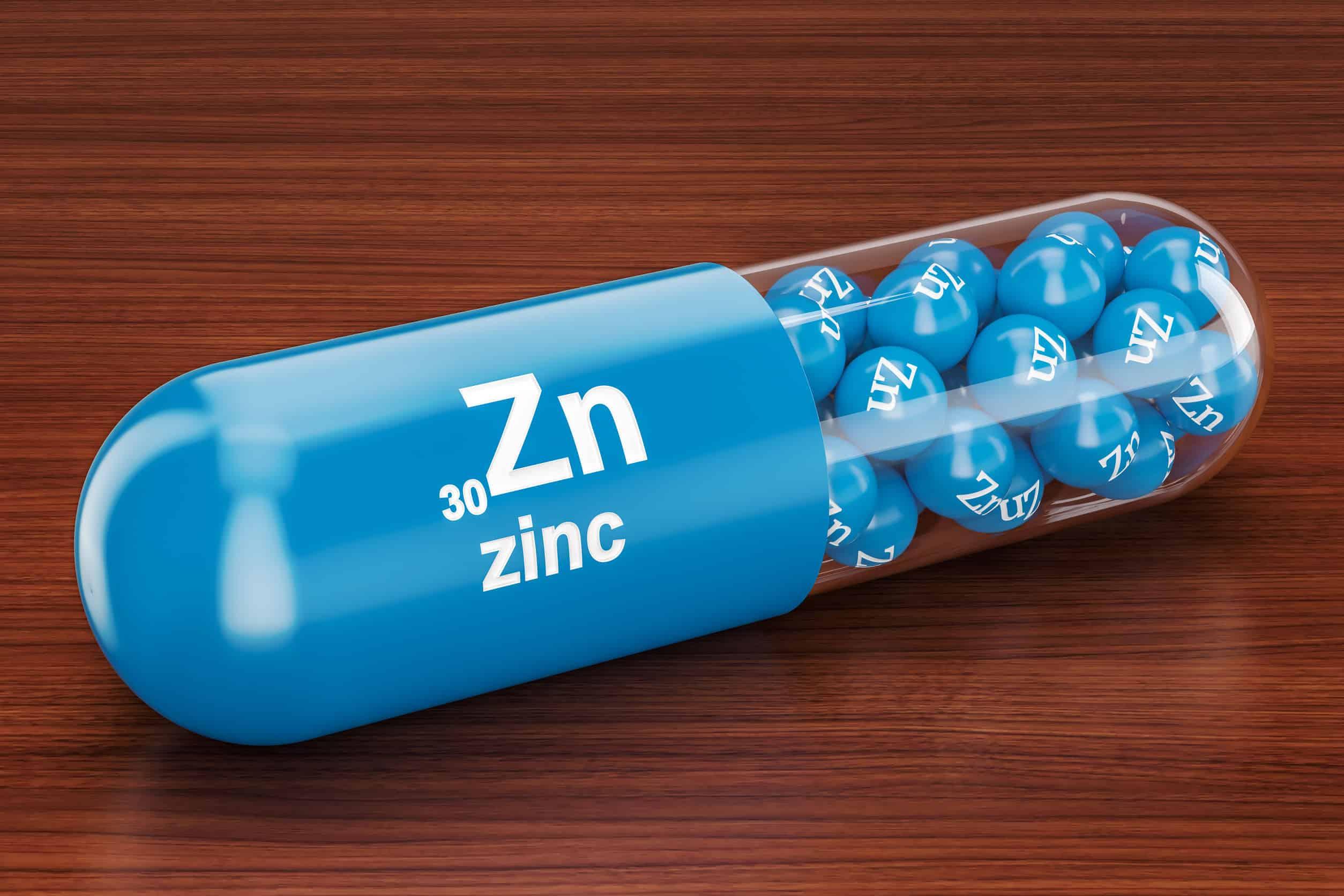 Cápsula com o símbolo Zn, de zinco.