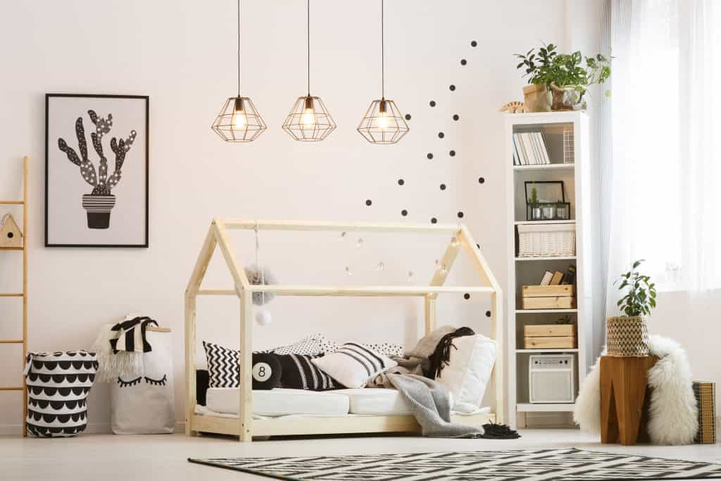 Children's room with montessori bed in black and white colors.