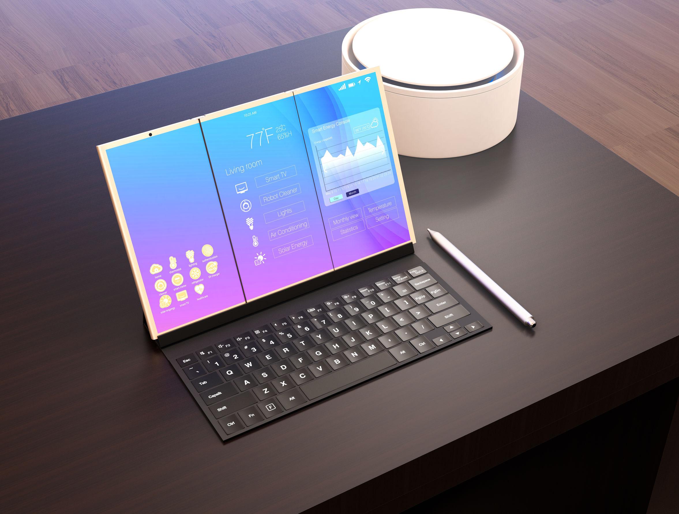 Tablet com teclado sobre mesa de escritório.