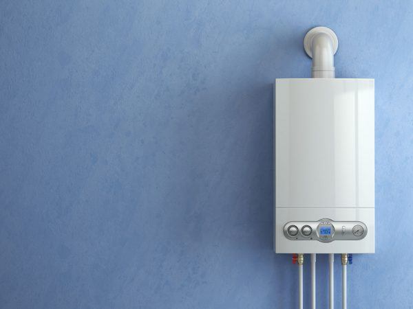 Imagem de aquecedor a gás Lorenzetti em parede azul