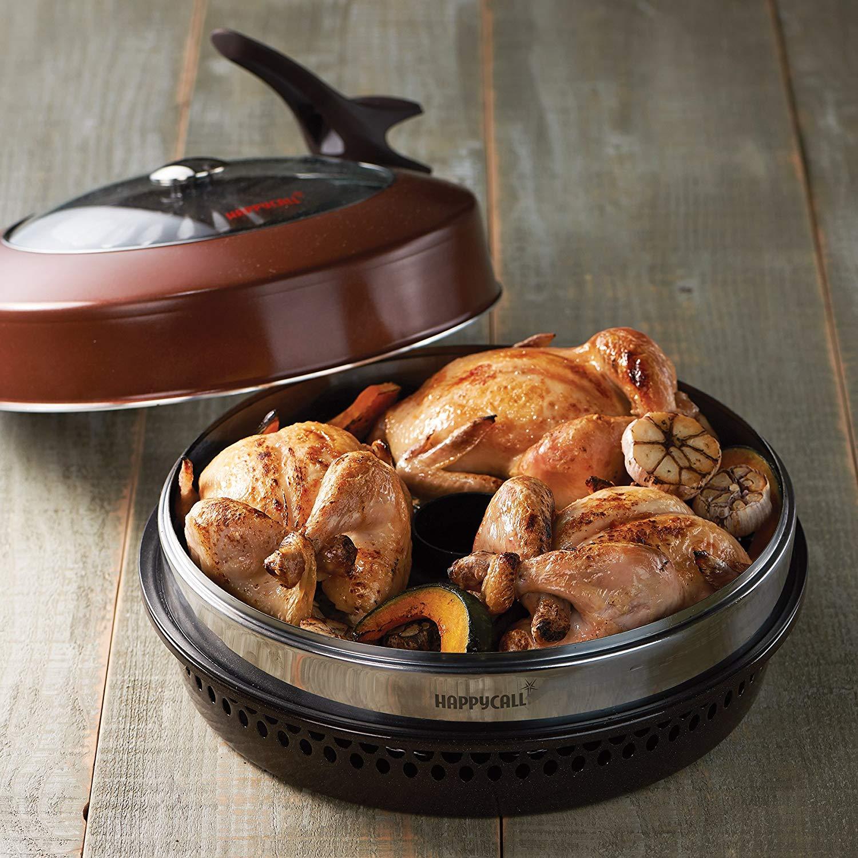 Na foto há uma churrasqueira de fogão cheia de carne