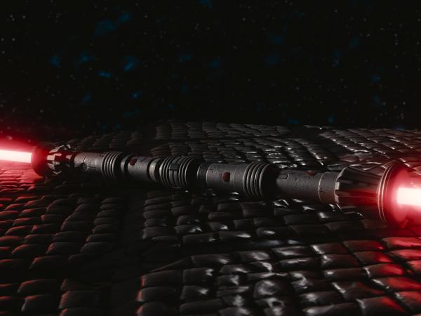 Imagem de sabre de luz duplos com lâminas vermelhas usado por Darth Maul