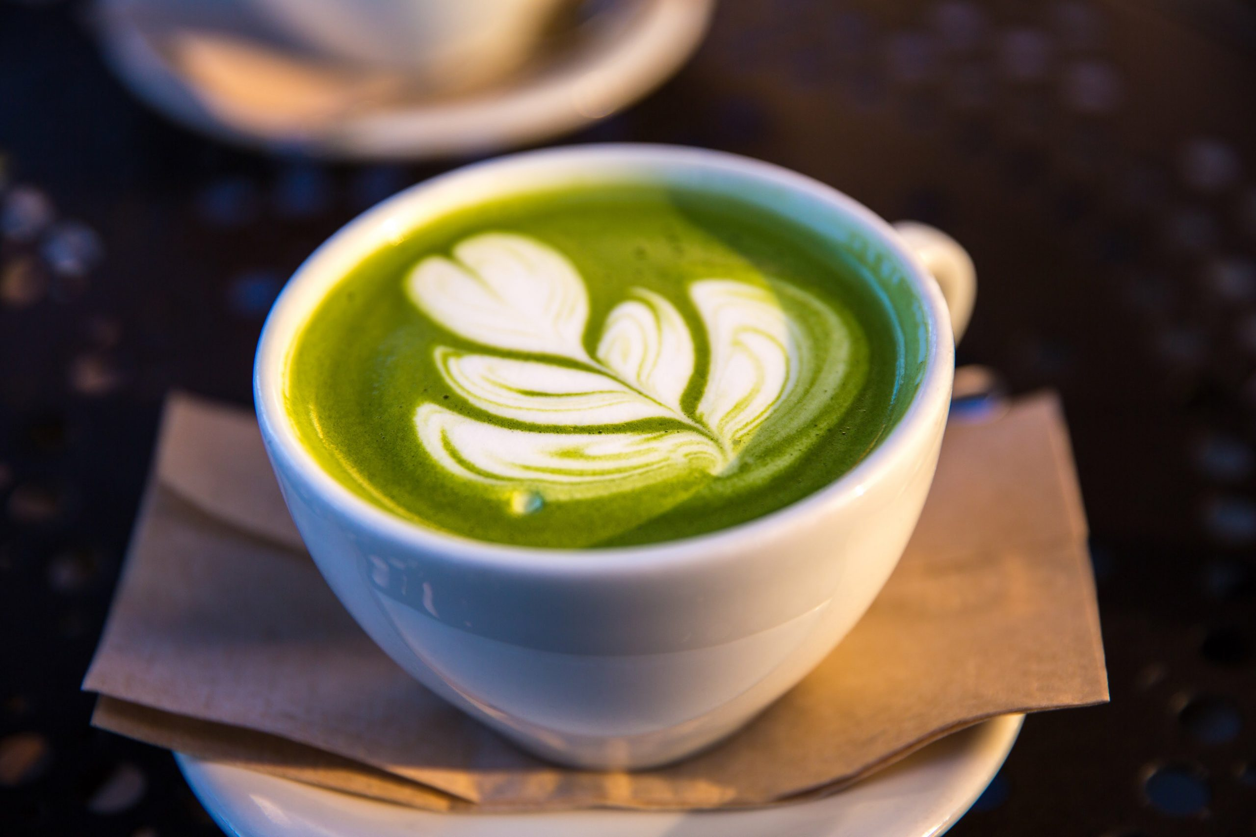 Imagem de uma xícara de café verde.