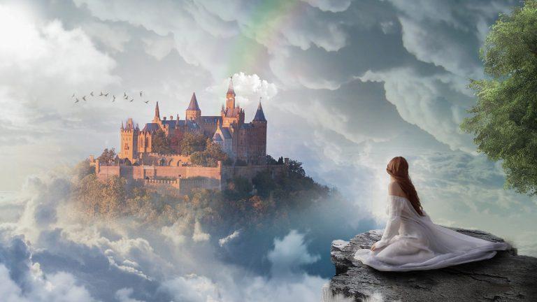 O desenho de uma mulher de vestido, de costas, sentada na beira de uma montanha, na frente dela existe um castelo gigante.
