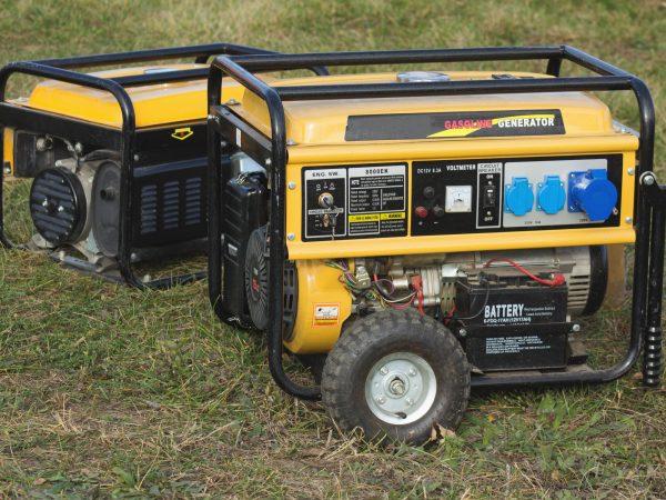 yellow petrol portable generator on wheels, close-up, emergency