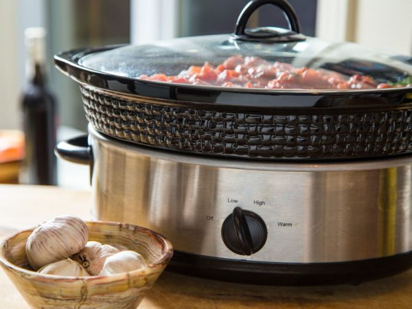 Slow cooker filled with a hot one-dish dinner that is ready to serve