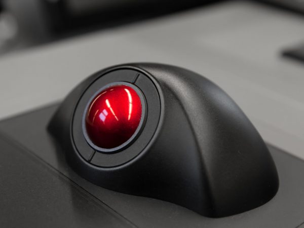 Industrial control panel with red trackball, close up photo with soft selective focus