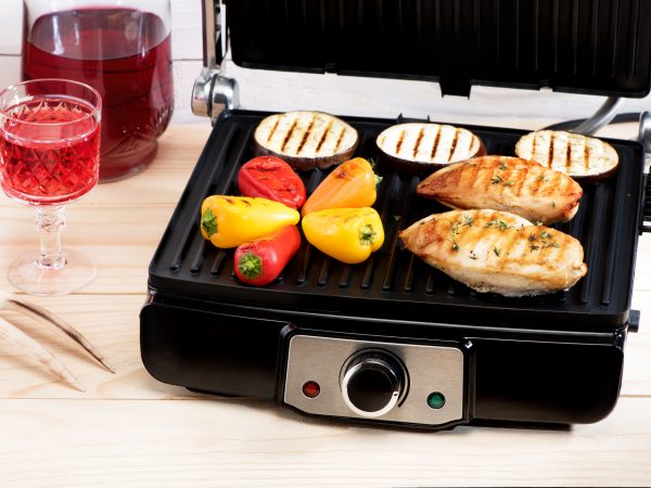 Chicken breast and vegetables on electric grill