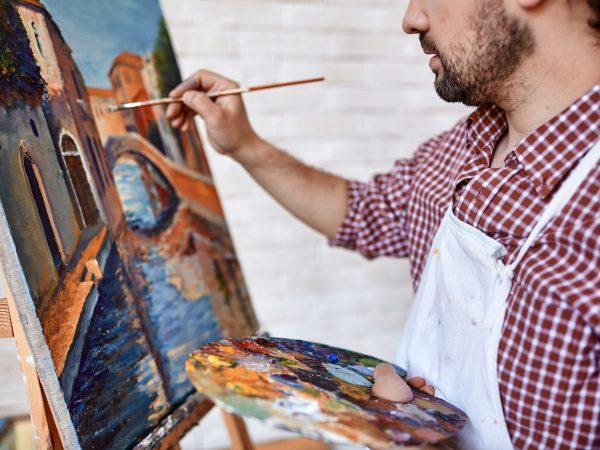 50498562 – modern artist painting landscape with oilpaints