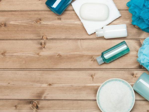 55427832 – spa kit top view. shampoo, soap bar and liquid. shower gel. aromatherapy salt.