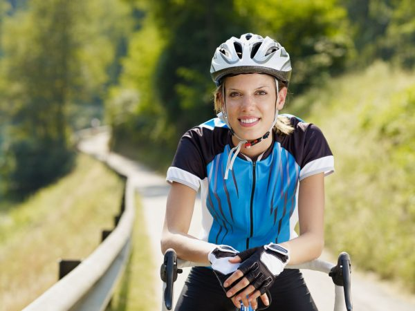5562198 – young woman on road bike. copy space